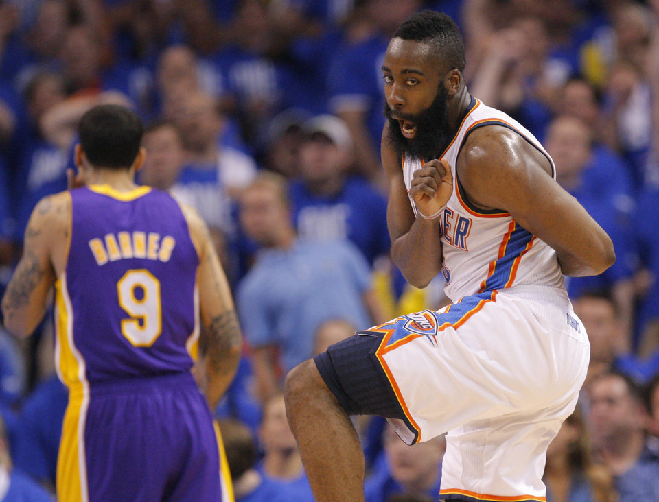 Oklahoma City's James Harden (13) reacts to a play in front of Los Angeles' Matt Barnes (9) during Game 1 in the second round of the NBA playoffs between the Oklahoma City Thunder and the L.A. Lakers at Chesapeake Energy Arena in Oklahoma City, Monday, May 14, 2012. Photo by Sarah Phipps, The Oklahoman