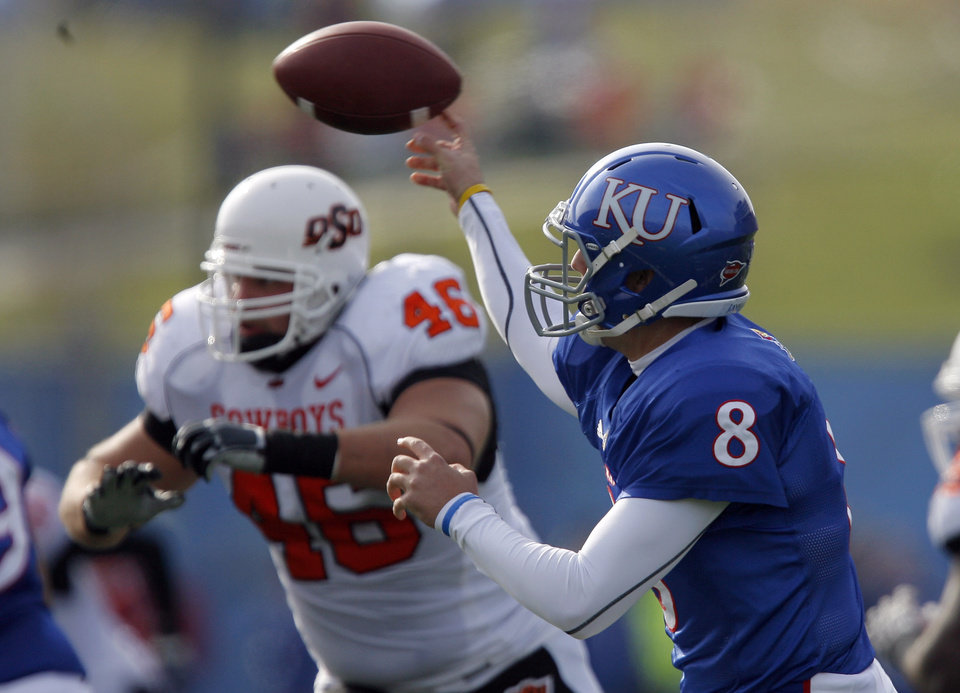 Photo - Kansas' Quinn Mecham (8) throws the ball during the college football game between Oklahoma State (OSU) and Kansas (KU), Saturday, Nov. 20, 2010 at Memorial Stadium in Lawrence, Kan. Photo by Sarah Phipps, The Oklahoman