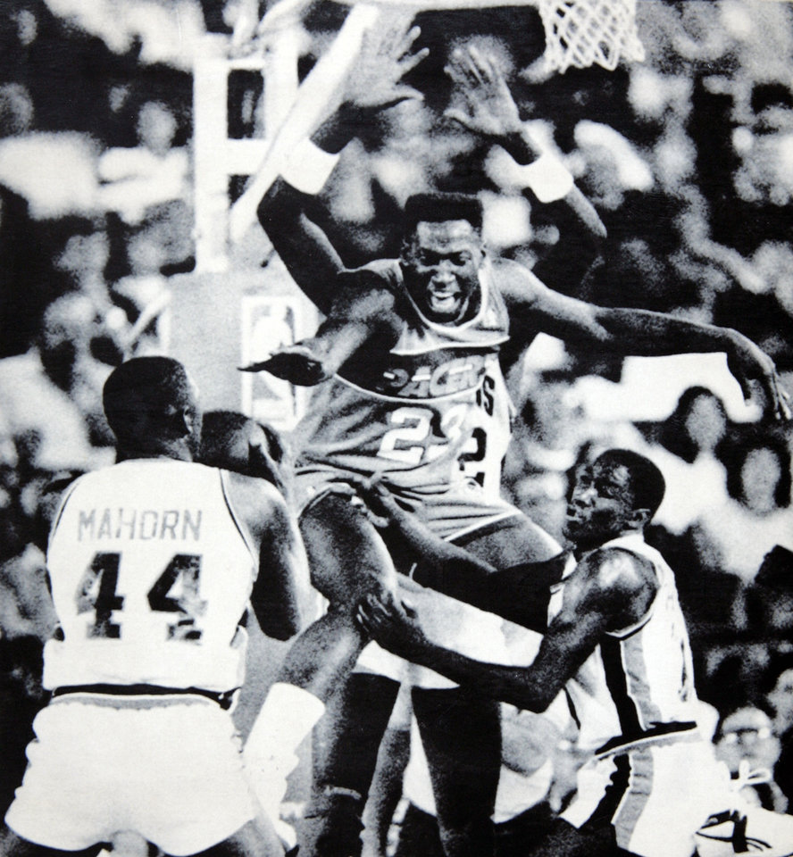 Former OU basketball player Wayman Tisdale. PONTIAC, Mich., April 3 --STEALING THE BALL -- Detroit Pistons\' Isiah Thomas (right) looks on as teammate Rick Mahorn (44) steals the ball from Indiana Pacers\' Wayman Tisdale (23) in the first half of Thursday night\'s NBA game at the Pontiac Silverdome. Detroit\'s John Salley is at rear. The Pistons took a 119-73 victory. (AP LaserPhoto) str-Richard Sheinwald. OPUBCO cutline - Detroit Pistons\' Isiah Thomas, right, watches as Rick Mahorn, left steals the ball from Indiana Pacers\' Wayman Tisdale Thursday. 4-4-87. ORG XMIT: KOD