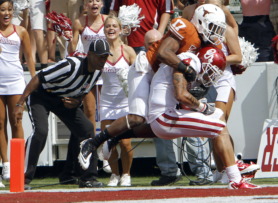 Oklahoma's Kenny Stills (4) scores a touchdown over the defense of Texas' Adrian Phillips (17) during the Red River Rivalry college football game between the University of Oklahoma Sooners (OU) and the University of Texas Longhorns (UT) at the Cotton Bowl in Dallas, Saturday, Oct. 8, 2011. Photo by Chris Landsberger, The Oklahoman
