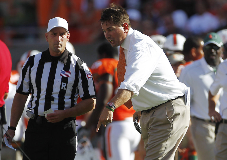 Miami coach Al Golden argues a penalty call that prevented his team from trying for a two point conversation during the second half of a NCAA college football game in Miami, Saturday, Oct. 13, 2012 against North Carolina. North Carolina won 18-14. (AP Photo/J Pat Carter)
