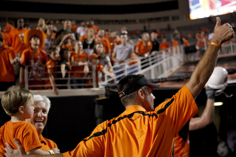 Photo - Oklahoma State head coach Mike Gundy salutes fans after the college football game between the University of Tulsa (TU) and Oklahoma State University (OSU) at Boone Pickens Stadium in Stillwater, Oklahoma, Saturday, September 18, 2010. Photo by Sarah Phipps, The Oklahoman