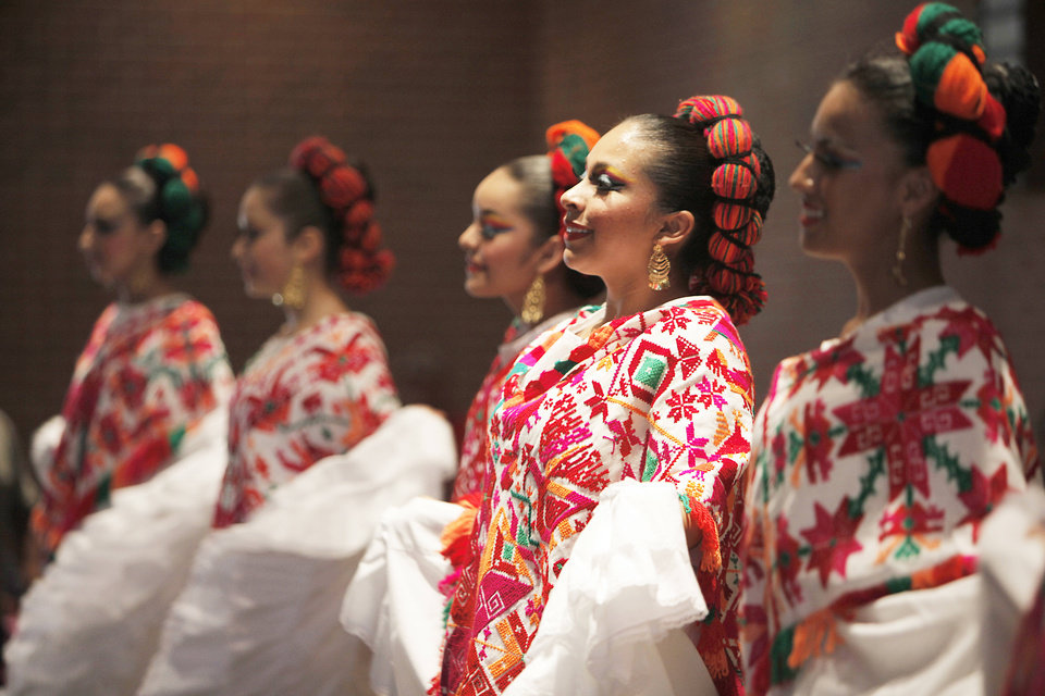 Photo - Dancers perform during a multicultural food festival at St. Eugene Catholic Church in Oklahoma City, Sunday, Sept. 9, 2012.  Photo by Garett Fisbeck, The Oklahoman  Garett Fisbeck - Garett Fisbeck