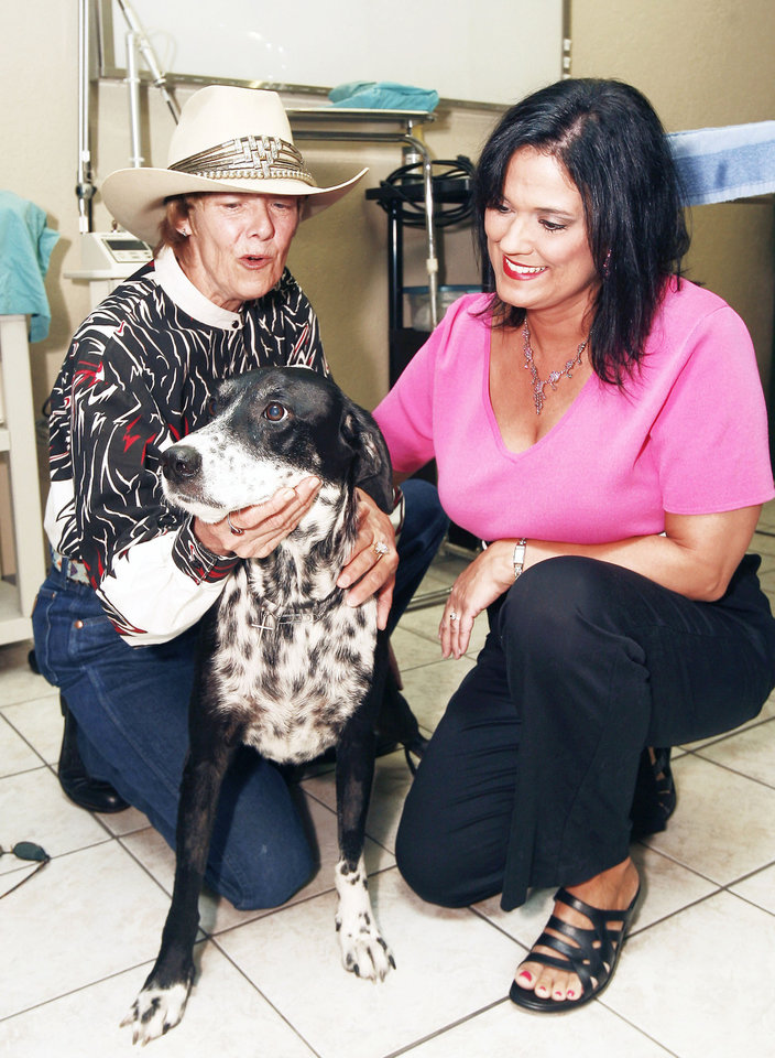 Dr. Donna Woods, right, looks over Pepper at Danforth Animal Hospital in Edmond.  Photo By Paul Hellstern,  The Oklahoman