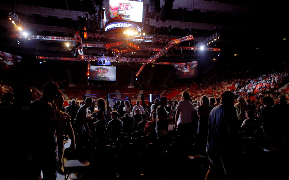 Photo - Fans watch during UFC Fight Night at the Cox Convention Center in Oklahoma City, Wednesday, September 16, 2009.  Photo by Bryan Terry, The Oklahoman