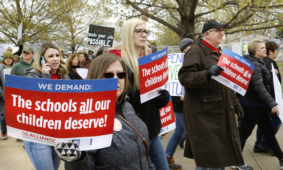 Photo - Teachers from throughout the state converged at the Capitol to bring their concerns about education funding to the attention of legislators and state officials during the first day of a statewide public schools teacher walkout  on Monday, April 2, 2018. Photo by Jim Beckel, The Oklahoman