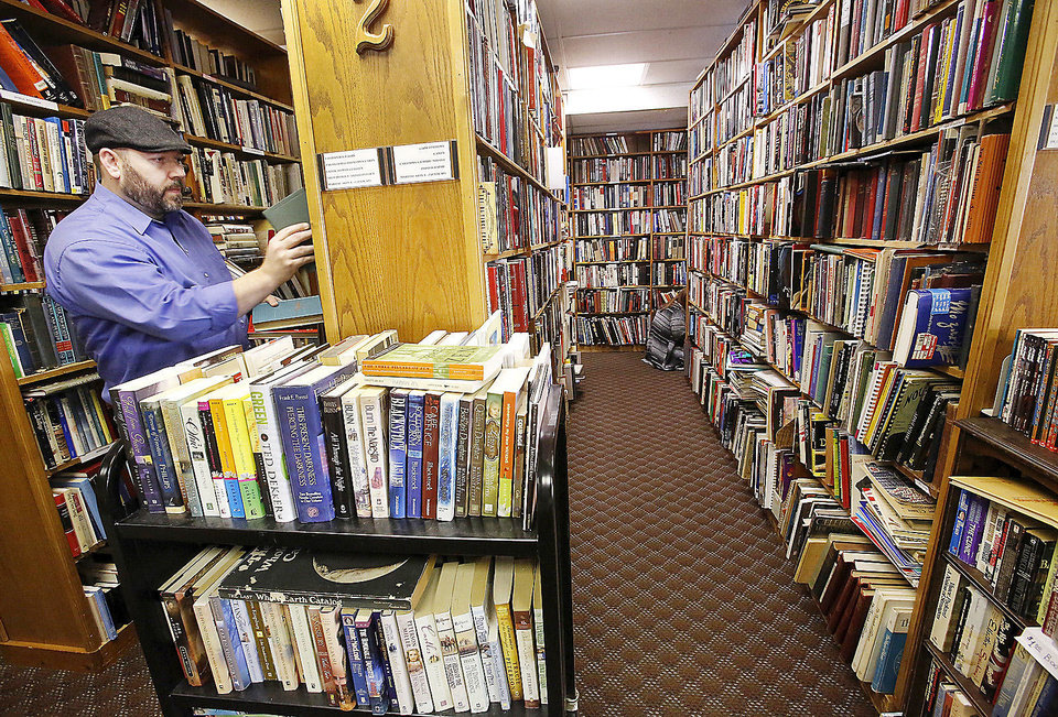 Clay Olson, Oklahoma City, shops for books. Despite a fire that could have destroyed more than 40,000 rare and used books at a landmark Oklahoma City bookstore, Aladdin Book Shoppe remains open for customers last Saturday, Dec. 22, 2012. Photo by Jim Beckel, The Oklahoman