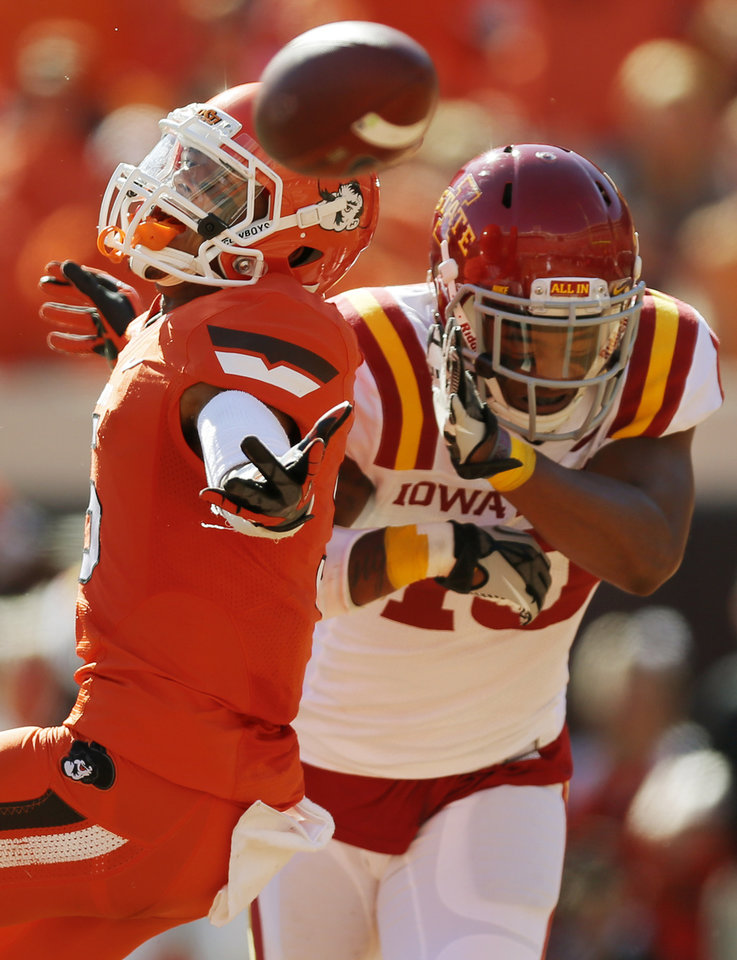 Photo - A pass intended for Oklahoma State's Josh Stewart (5) falls incomplete as Iowa State's Jacques Washington (10) defends during a college football game between Oklahoma State University (OSU) and Iowa State University (ISU) at Boone Pickens Stadium in Stillwater, Okla., Saturday, Oct. 20, 2012. Washington was called for a foul on the play. Photo by Nate Billings, The Oklahoman