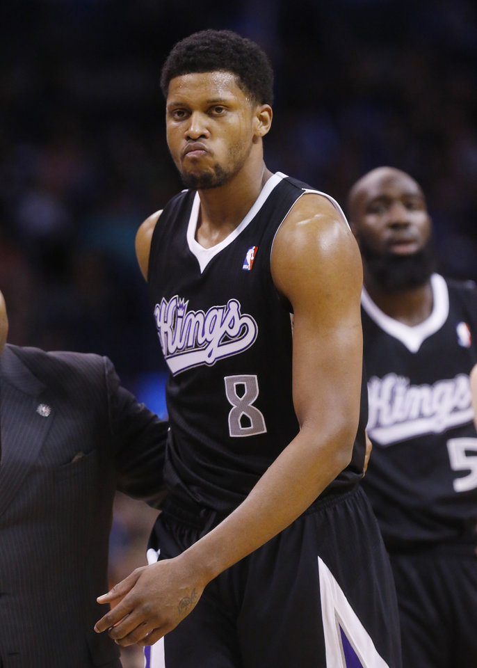 Photo - Sacramento Kings forward Rudy Gay (8) leaves the court after being ejected from the game in the fourth quarter of an NBA basketball game against the Oklahoma City Thunder in Oklahoma City, Sunday, Jan. 19, 2014. Oklahoma City won 108-93. (AP Photo/Sue Ogrocki)