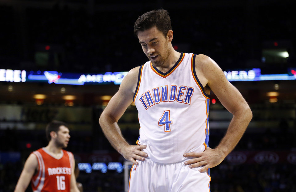 Photo - Oklahoma City's Nick Collison (4) reacts after a foul during the NBA game between the Oklahoma City Thunder and the Houston Rockets at Chesapeake Energy Arena, Sunday, Nov. 16, 2014.  Photo by Sarah Phipps, The Oklahoman