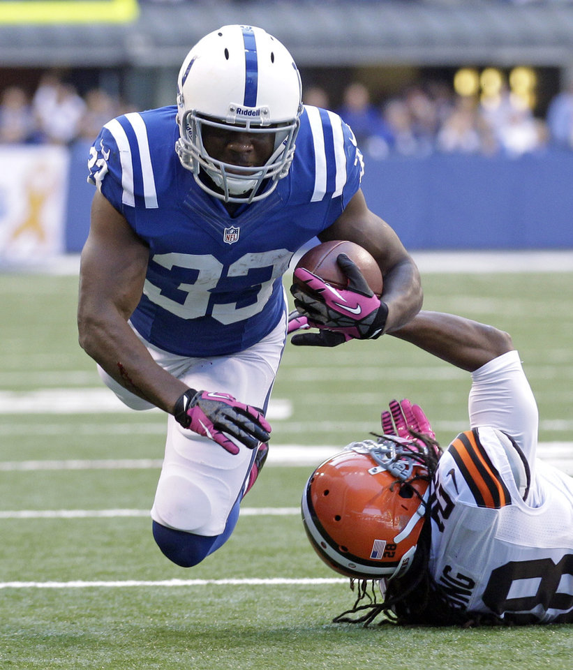 Photo -   Indianapolis Colts' Vick Ballard is tackled by Cleveland Browns' Usama Young during the first half of an NFL football game Sunday, Oct. 21, 2012, in Indianapolis. (AP Photo/Michael Conroy)