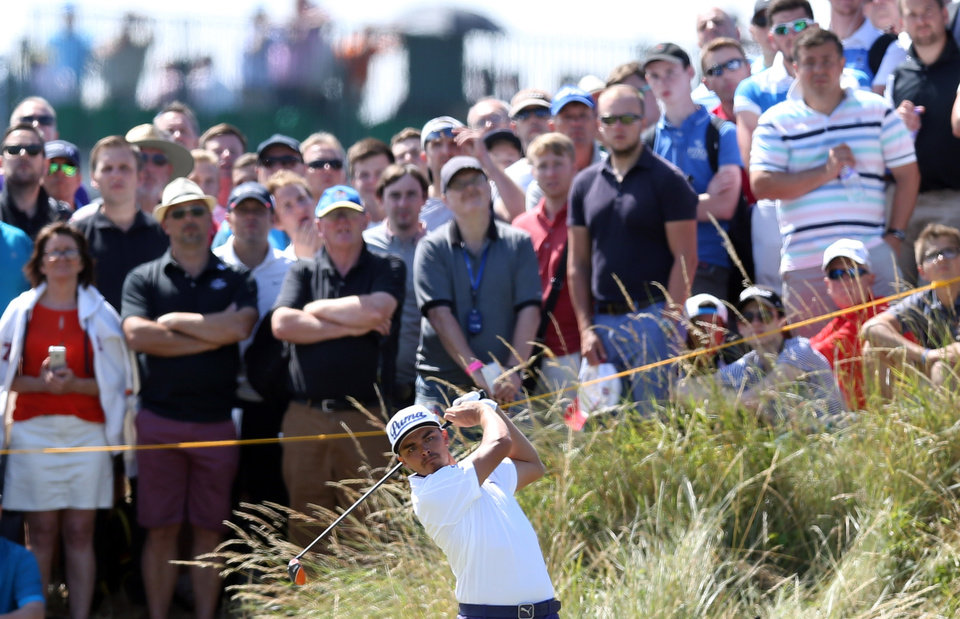 Rickie Fowler of the US plays a shot off the 14th tee during the first day of the British Open Golf championship at the Royal Liverpool golf club, Hoylake, England, Thursday July 17, 2014. (AP Photo/Scott Heppell)