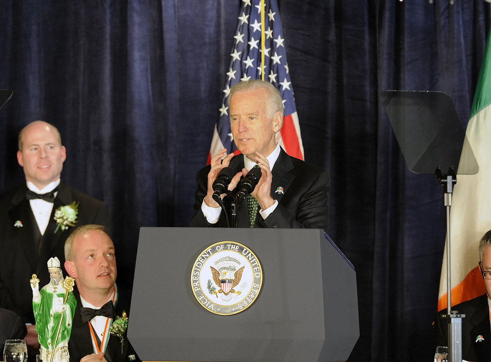 Photo - Vice President Joe Biden gestures during his speech at the Greater Pittston Area Friendly Sons of St Patrick Dinner Monday, March 17, 2014 at the Woodlands Inn and Resort, Plains, Pa. (AP Photo/The Citizens' Voice, Mark Moran)