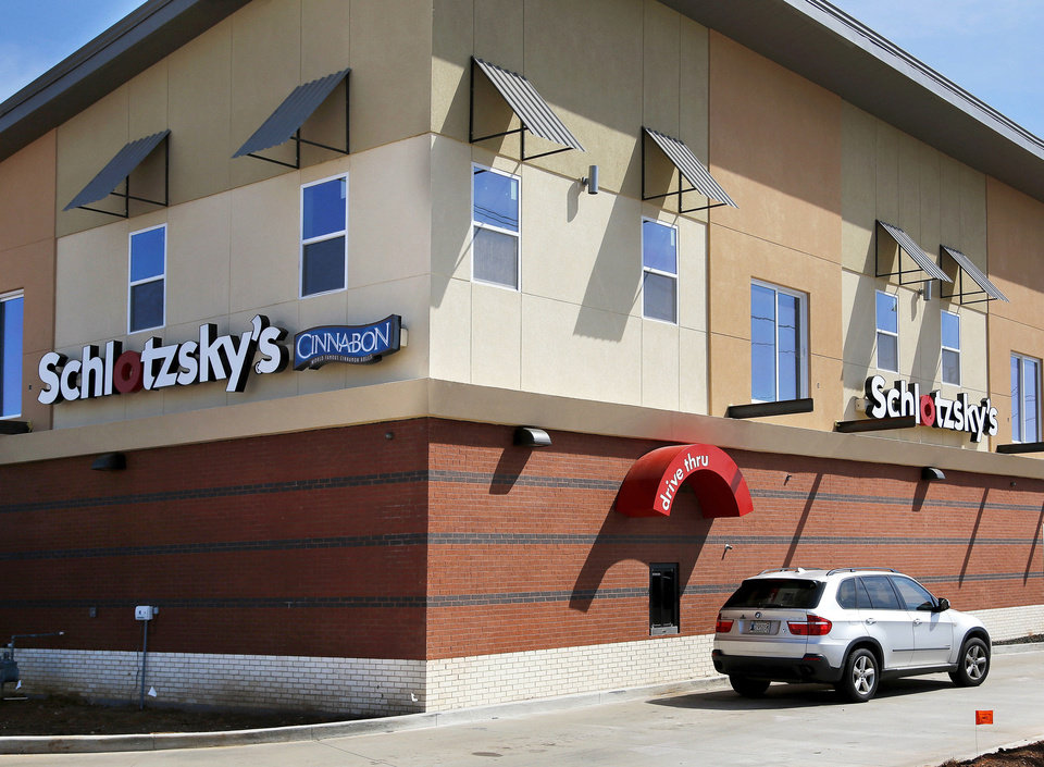 Midwest City's new Schlotzsky's features upscale apartments above and a slanted roof, meant to invoke the look of an airplane.