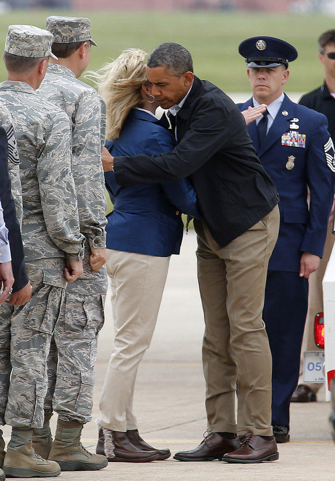 Photo - President Barack Obama hugs Gov. Mary Fallin after arriving at Tinker Air Force base in Midwest City, Sunday, May 26, 2013. Obama was in town to visit areas damaged by the May 20 tornado. Photo by Sarah Phipps, The Oklahoman