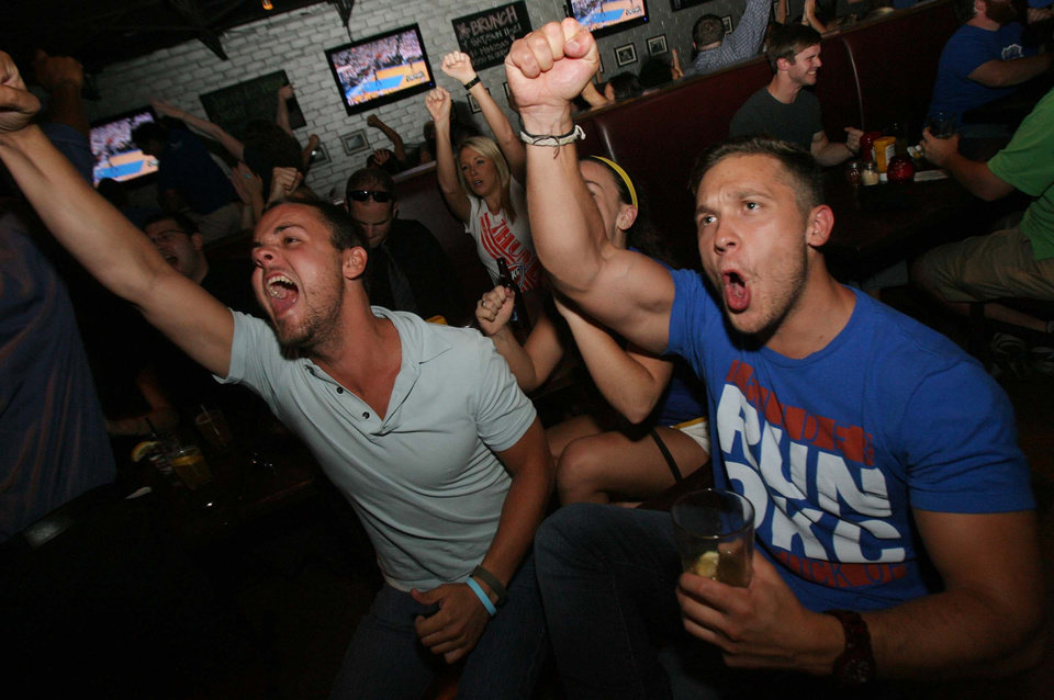 Oklahoma City Thunder fans Connor Ellingson (left) from Tulsa, and Maurice Fell from Tulsa, react to the Thunder defeating San Antonio while watching the game at Leon's on Brookside, in Tulsa, Okla, on June 6 2012. Photo by James Gibbard/Tulsa World