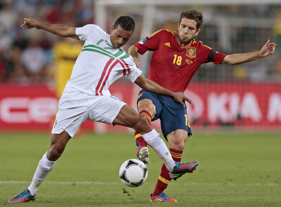 Portugal's Nani, left, and Spain's Jordi Alba vie for the ball during the Euro 2012 soccer championship semifinal match between Spain and Portugal in Donetsk, Ukraine, Wednesday, June 27, 2012. (AP Photo/Ivan Sekretarev)
