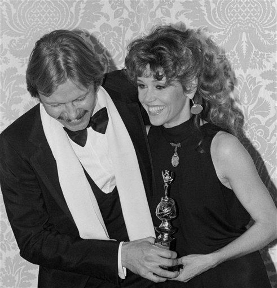 Actor Jon Voight congratulates actress Jane Fonda after Fonda received her award as the world film favorite at the Hollywood Foreign Press Associations 1980 Golden Globe Awards show in Los Angeles, on Saturday, night, Jan. 27, 1980. Fonda shared the honors with actor Roger Moore. This award is determined according to the result of a world wide survey by the Reuters News Bureau. (AP Photo/ George Brich)