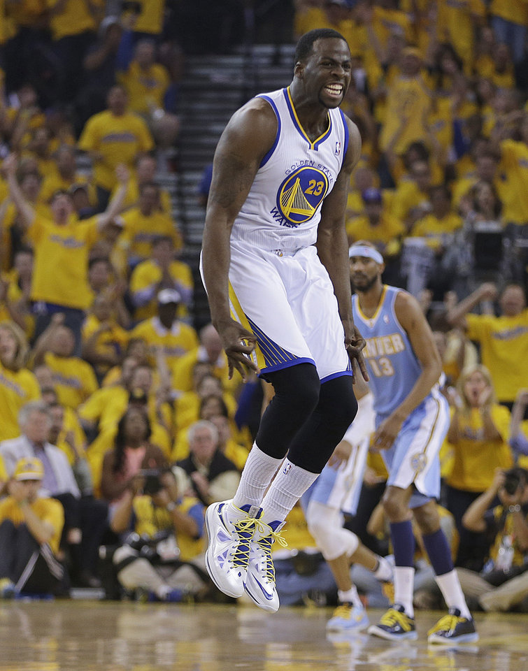 Photo - Golden State Warriors' Draymond Green (23) ceelbrates after scoring against the Denver Nuggets during the first half of Game 6 in a first-round NBA basketball playoff series, Thursday, May 2, 2013, in Oakland, Calif. (AP Photo/Ben Margot)