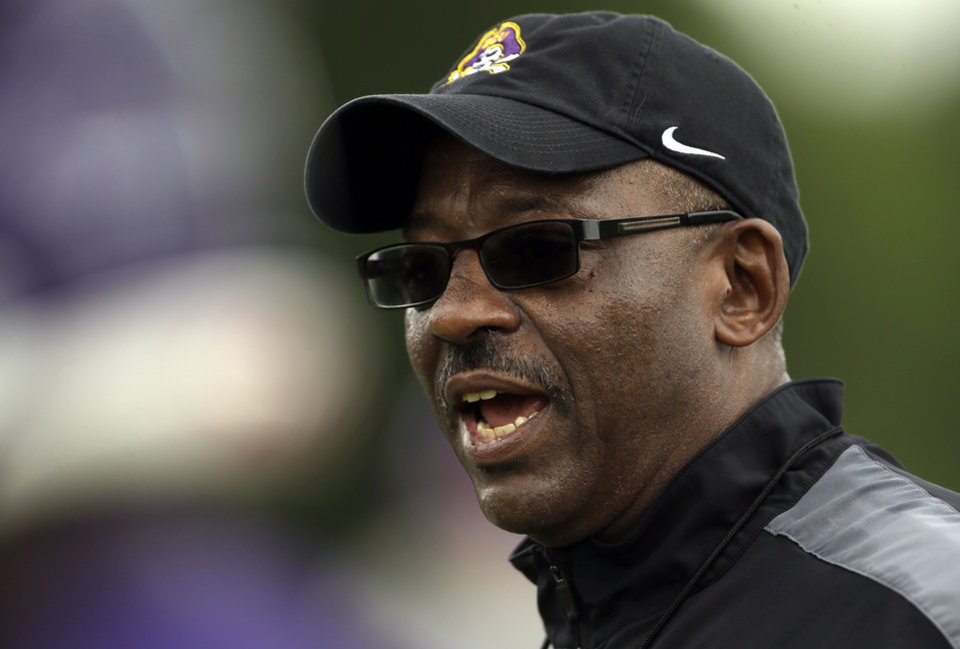 Photo - East Carolina coach Ruffin McNeill watches his team during an NCAA college football practice in Greenville, N.C., Tuesday, Aug. 5, 2014. (AP Photo/Gerry Broome)