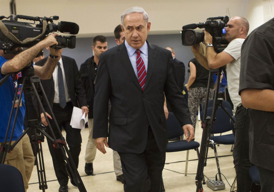 Photo - Israeli Prime Minister Benjamin Netanyahu leaves a press conference in Tel Aviv, Israel, Sunday, June 15, 2014. Netanyahu has condemned Palestinian President Mahmoud Abbas' agreement with the militant group, and said he would hold him responsible for the safety of the youths, who disappeared apparently while hitchhiking in the West Bank late Thursday. (AP Photos/Dan Balilty)