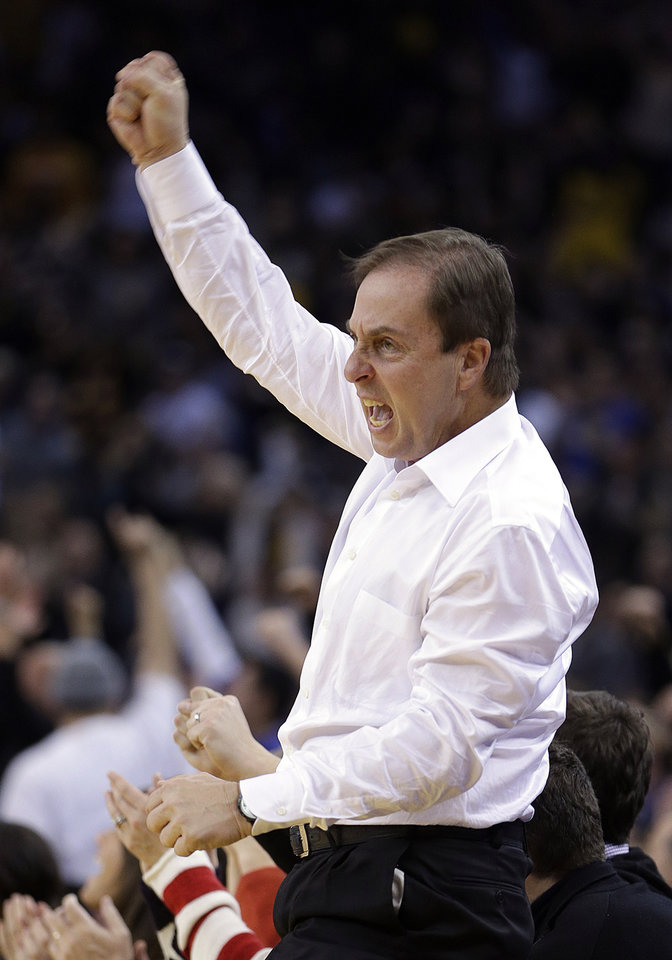 Golden State Warriors' co-owner  Joe Lacob celebrates as the Warriors score during the final seconds of the NBA basketball game against the Oklahoma City Thunder  Wednesday, Jan. 23, 2013, in Oakland, Calif. (AP Photo/Ben Margot)