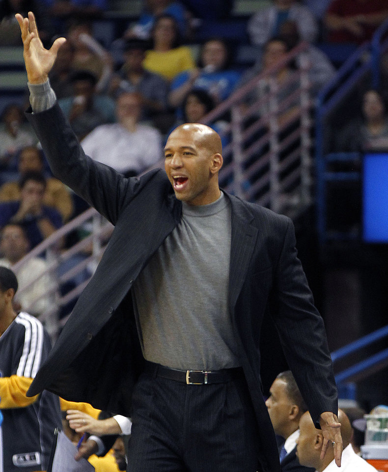 New Orleans Hornets head coach Monty Williams calls out to the officials in the second half of an NBA basketball game against the Milwaukee Bucks in New Orleans, Monday, Dec. 3, 2012. The Hornets won 102-81. (AP Photo/Gerald Herbert)