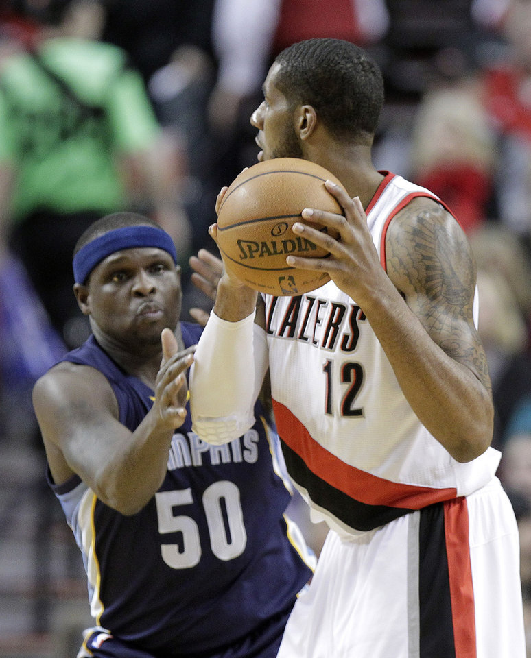 Photo - Portland Trail Blazers forward LaMarcus Aldridge, right, looks to pass as Memphis Grizzlies forward Zach Randolph defends during the first half of an NBA basketball game in Portland, Ore., Tuesday, Jan. 28, 2014. (AP Photo/Don Ryan)