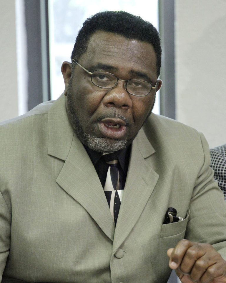 Photo - Minister Reginald Mitchell, NAACP, president, Oklahoma City branch, speaks at a press conference held by the Oklahoma State Conference NAACP Friday, May 29, 2009. Photo by Doug Hoke, The Oklahoman.