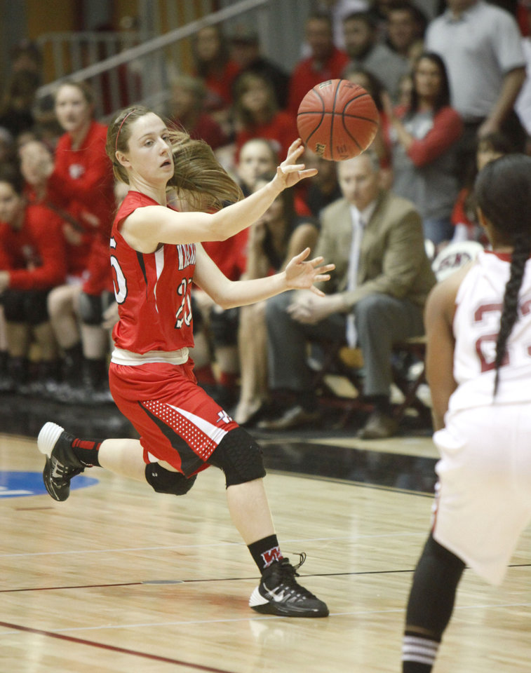 Photo - Washington's Brenna Busby passes the ball during the Class 3A Girls quarterfinal basketball game at Southern Nazarene University's Sawyer Center in Bethany, OK, Thursday, March 13, 2014,  Photo by Paul Hellstern, The Oklahoman