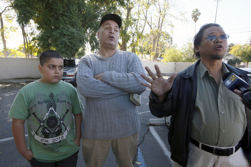 Photo -   From left, Mohammad Atia with his father Gamal Atia , and Muhammad Sanusi speak near their home in Pomona, Calif., Tuesday Nov.20, 2012, about their neighbor, Sohiel Omar Kabir who was arrested along with three other men accused of plotting to kill Americans and destroy U.S. targets overseas by joining al-Qaida and the Taliban in Afghanistan. ( AP Photo/Nick Ut)
