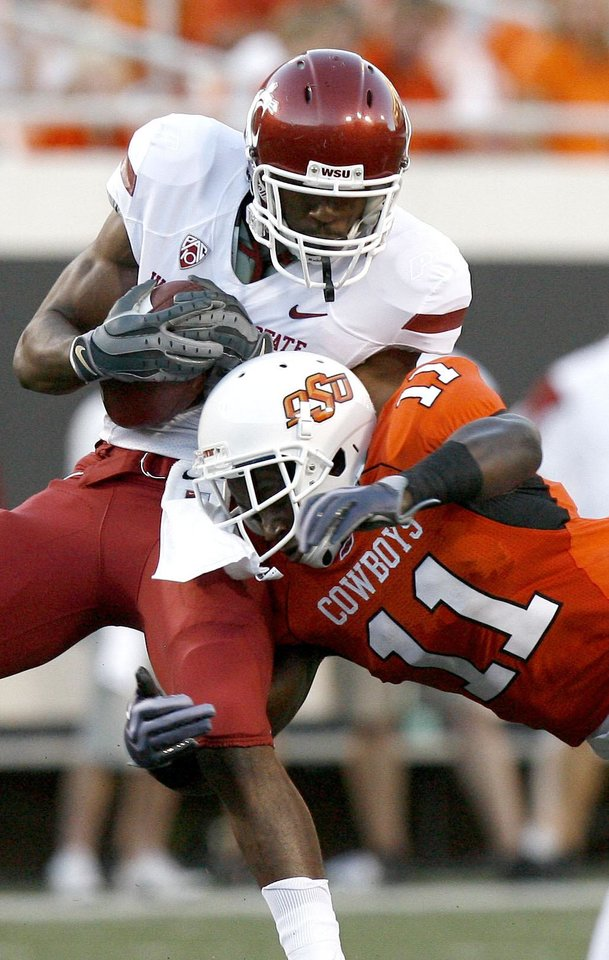 Photo - OSU's Shaun Lewis (11) and Isiah Barton (81) during the college football game between the Washington State Cougars (WSU) and the Oklahoma State Cowboys (OSU) at Boone Pickens Stadium in Stillwater, Okla., Saturday, September 4, 2010. Photo by Sarah Phipps, The Oklahoman