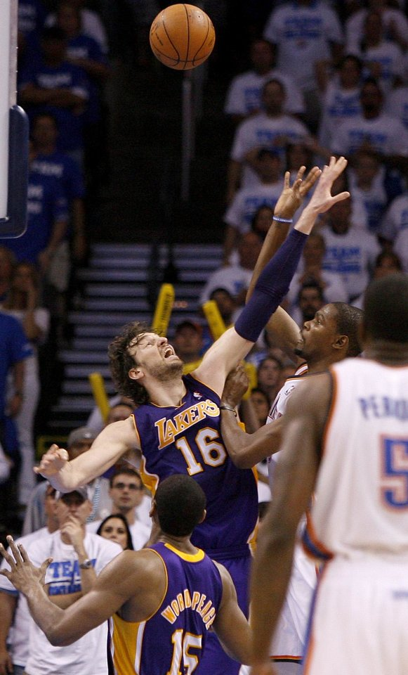 Oklahoma City's Kevin Durant (35) shots a basket over Los Angeles' Pau Gasol (16) and Metta World Peace (15) putting the Thunder up by one in the final seconds of Game 2 in the second round of the NBA playoffs between the Oklahoma City Thunder and L.A. Lakers at Chesapeake Energy Arena in Oklahoma City, Wednesday, May 16, 2012. Photo by Bryan Terry, The Oklahoman