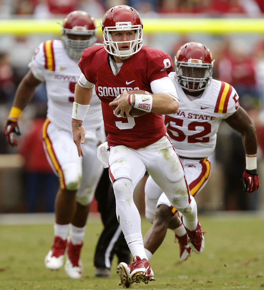 Oklahoma's Trevor Knight (9) runs past Iowa State's Jeremiah George (52) during the college football game between the University of Oklahoma Sooners (OU) and the Iowa State University Cyclones (ISU) at Gaylord Family-Oklahoma Memorial Stadium in Norman, Okla. on Saturday, Nov. 16, 2013. Photo by Chris Landsberger, The Oklahoman
