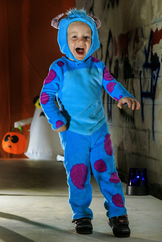 Photo - He may look frightening - but this monster is a well-loved Monsters Inc. character. Chase is wearing a Sully costume, which is sure to make your little monster the scariest trick-or-treater on the block. The costume includes the jumpsuit, detachable tail and headpiece. Costume sold at Party Galaxy. Photo by Chris Landsberger, The Oklahoman.  CHRIS LANDSBERGER