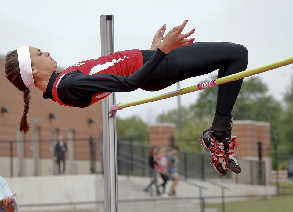 Photo - Grove's Emilee Iverson competes in the Class 5A girls high jump during the Class 6A and 5A state championship track meet at Yukon High School on Saturday, May 17, 2014 in Yukon, Okla.   Photo by Chris Landsberger, The Oklahoman