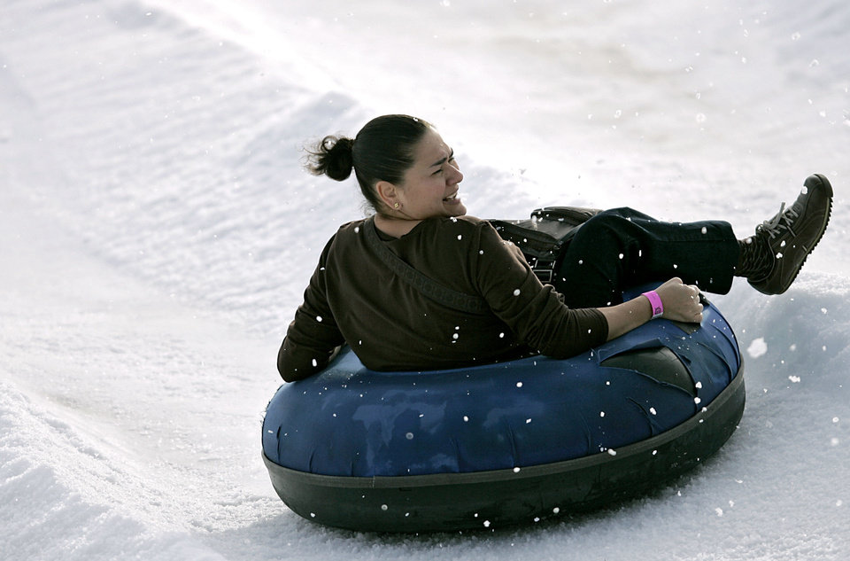 Anna Graham slides to the bottom of the slide during the Cheseapeake Snow Tubing at the Bricktown Ballpark in Oklahoma City on Monday, Dec. 20, 2010. Photo by John Clanton, The Oklahoman Archives <strong>John Clanton - The Oklahoman</strong>