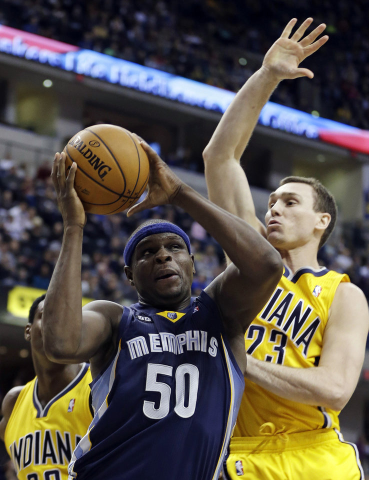 Photo - Memphis Grizzlies' Zach Randolph (50) is fouled by Indiana Pacers' Ben Hansbrough (23) as he goes up for a shot during the first half of an NBA basketball game, Monday, Dec. 31, 2012, in Indianapolis. (AP Photo/Darron Cummings)