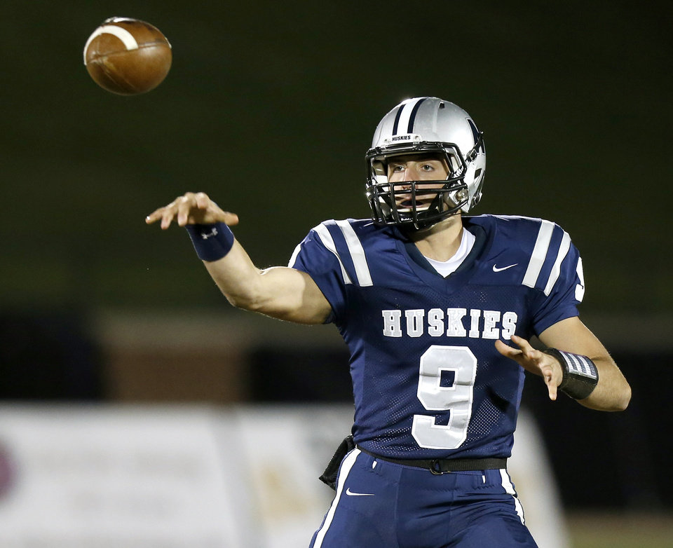 Edmond North's Luke Hoskins passes the ball during a high school football game against Midwest City at Wantland Stadium in Edmond, Thursday, October 25, 2012. Photo by Bryan Terry, The Oklahoman