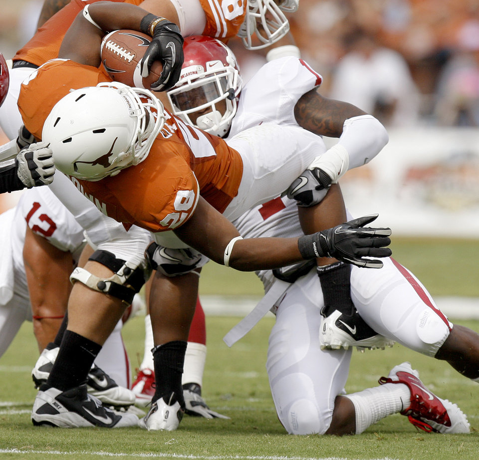 Oklahoma's Tony Jefferson (1) brings down Texas' Malcolm Brown (28) during the Red River Rivalry college football game between the University of Oklahoma Sooners (OU) and the University of Texas Longhorns (UT) at the Cotton Bowl in Dallas, Saturday, Oct. 8, 2011. Photo by Bryan Terry, The Oklahoman
