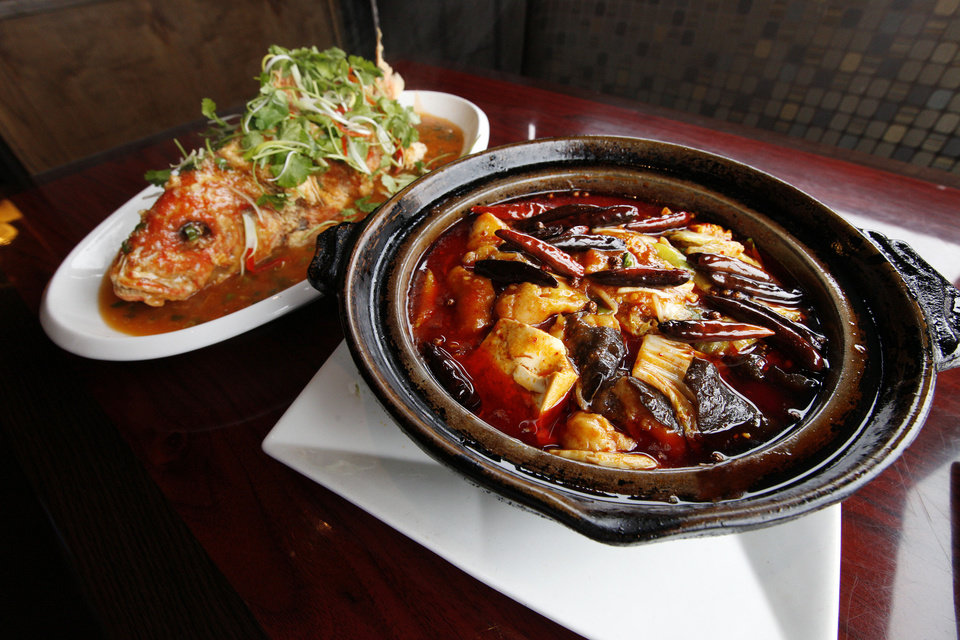 Crispy Whole Red Snapper and Hot & Spicy Sliced Fish in Clay Pot at the Szechuan Bistro, 1010 W Memorial Road, in Oklahoma City. <strong>PAUL B. SOUTHERLAND - THE OKLAHOMAN</strong>