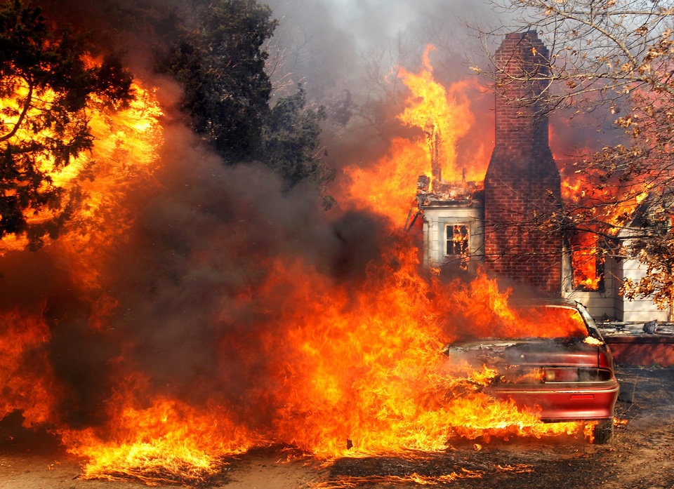 A home, car and trees in the 2100 block of N Dobbs Road in Harrah is an inferno Friday, March 11, 2011. Photo by Jim Beckel, The Oklahoman