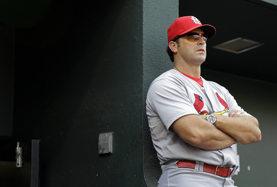 Photo - St. Louis Cardinals manager Mike Matheny watches from the dugout in the third inning of an interleague baseball game against the Baltimore Orioles, Saturday, Aug. 9, 2014, in Baltimore. (AP Photo/Patrick Semansky)