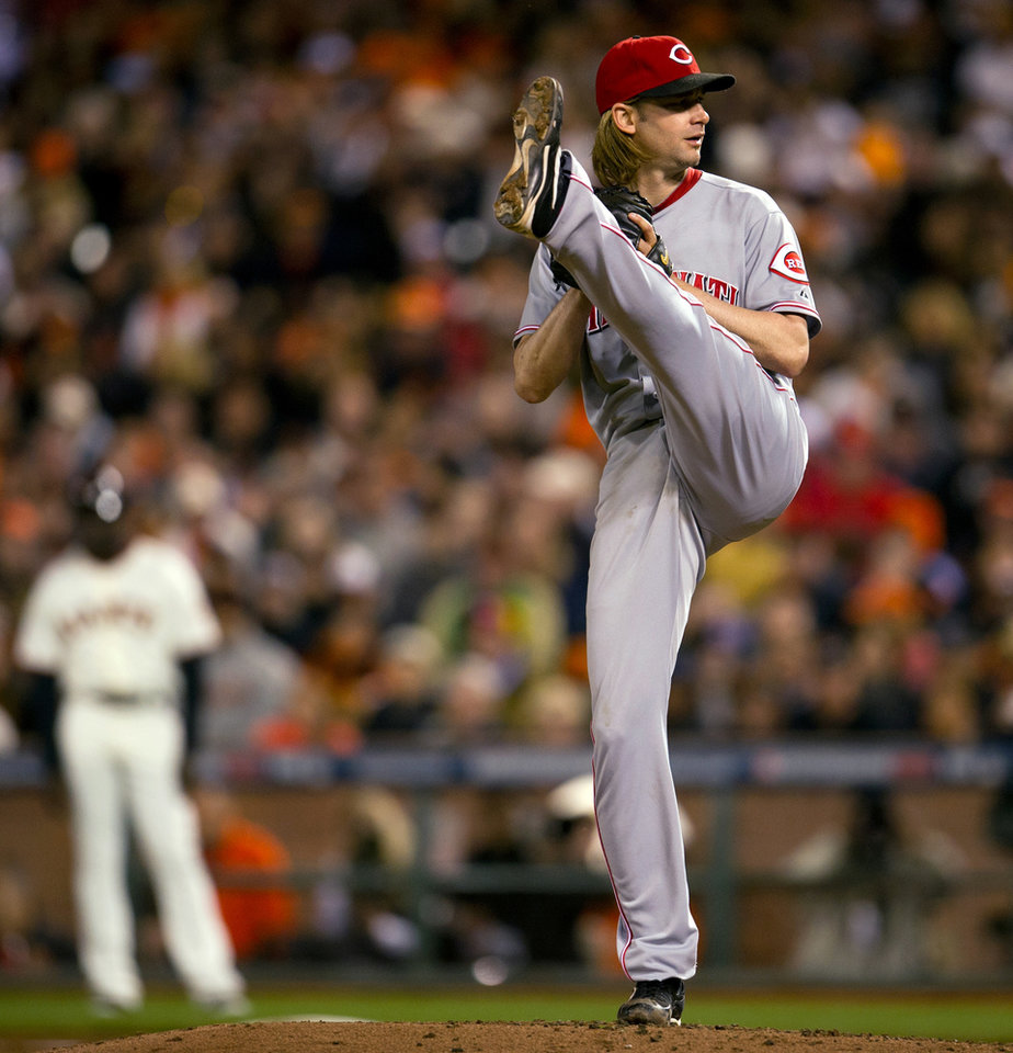 Cincinnati Reds starting pitcher Bronson Arroyo (61) delivers a pitch during Game 2 of the National League division baseball series against the San Francisco Giants, Sunday, Oct. 7, 2012, in San Francisco. (AP Photo/The Sacramento Bee, Paul Kitagaki Jr.)