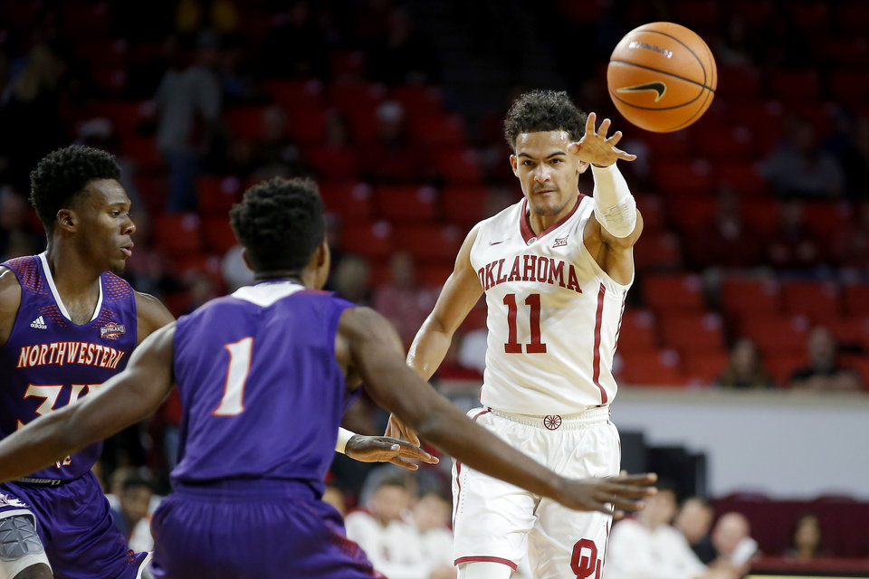 Photo - Oklahoma's Trae Young (11) passes the ball around Northwestern State's Iziahiah Sweeney (1) and Brandon Hutton (34) during an NCAA basketball game between the University of Oklahoma Sooners (OU) and the Northwestern State Demons inside the Lloyd Noble Center in Norman, Okla., Tuesday, Dec. 19, 2017. Photo by Bryan Terry, The Oklahoman