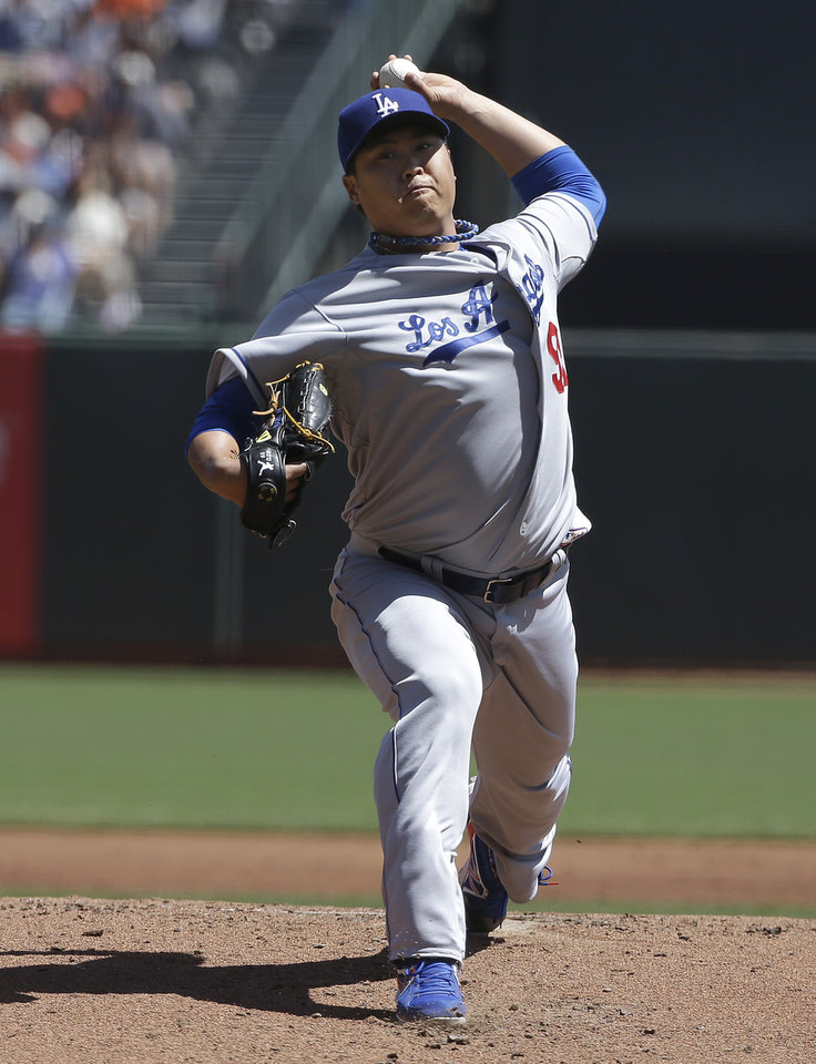 Photo - Los Angeles Dodgers pitcher Hyun-jin Ryu, from South Korea, throws against the San Francisco Giants during the first inning of a baseball game in San Francisco, Thursday, April 17, 2014. (AP Photo/Jeff Chiu)
