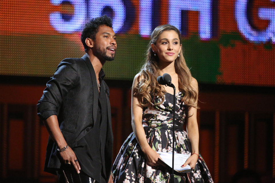 Photo - Miguel, left, and Ariana Grande present the award for best pop solo performance at the 56th annual Grammy Awards at Staples Center on Sunday, Jan. 26, 2014, in Los Angeles. (Photo by Matt Sayles/Invision/AP)