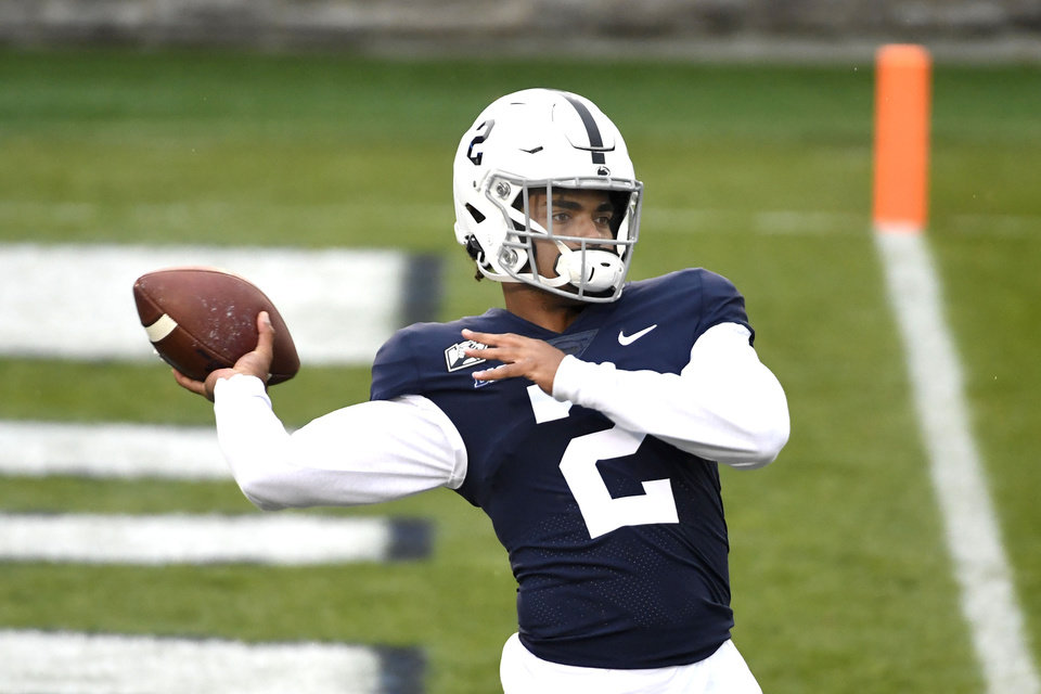 Photo - Penn State quarterback Micah Bowens (2) warms up for an NCAA college football game against Iowa in State College, Pa., on Saturday, Nov. 21, 2020. (AP Photo/Barry Reeger)