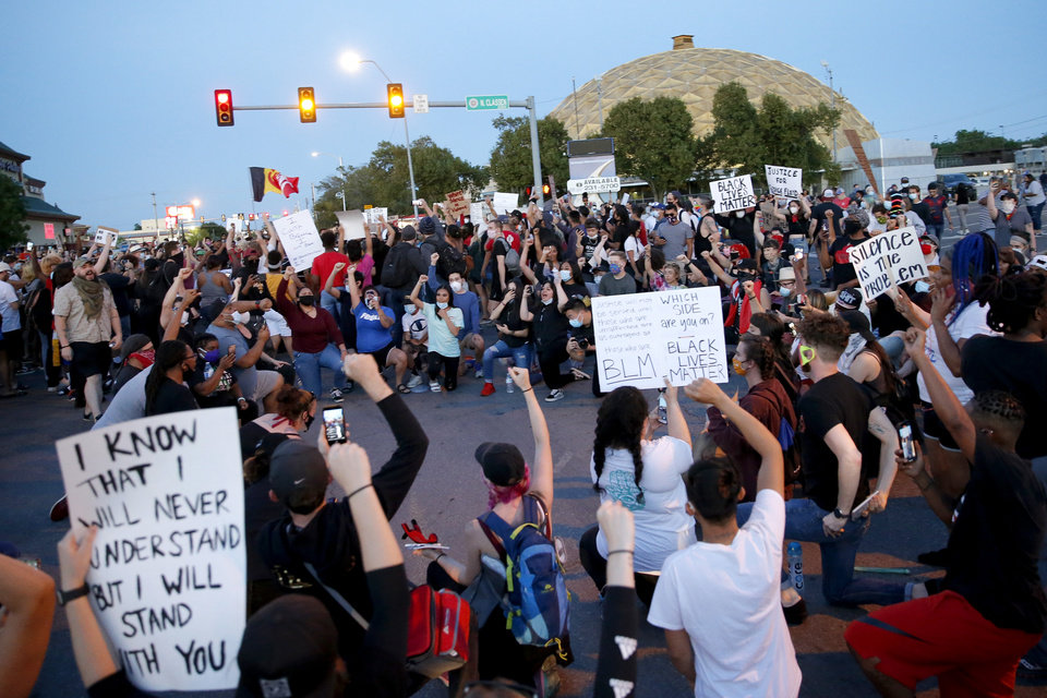 Photo - Protesters gather at the intersection at 23rd and Classen in Oklahoma City, Saturday, May 30, 2020. The protest was in response to the death of George Floyd. [Bryan Terry/The Oklahoman]