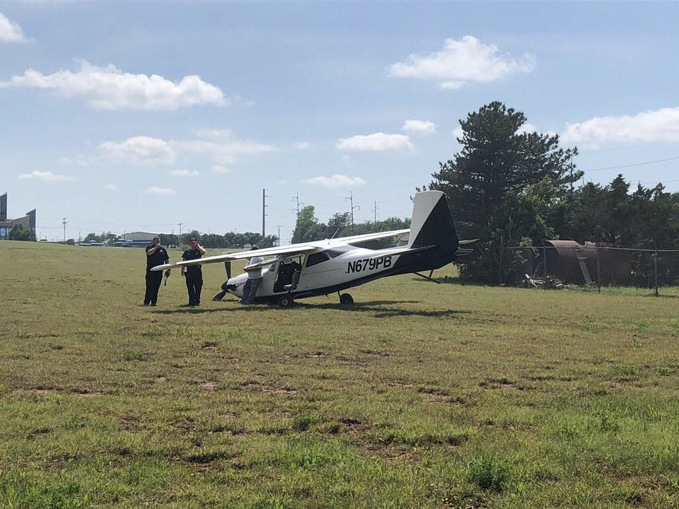 Photo -  A pilot made an emergency in Oklahoma City Monday after his plane ran out of fuel, fire officials said. [Twitter image/OKCFD]